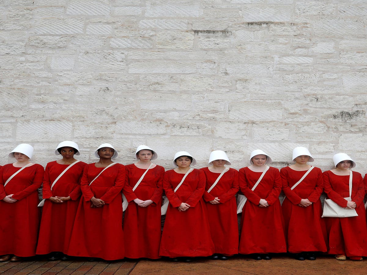 Women Wore Handmaid's Tale Outfits To Texas Senate & The Photos Are Creepy