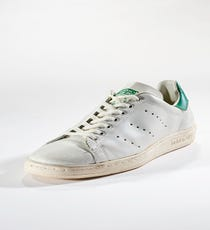"""Adidas Stan Smith, ca. 1980sStan Smiths grew out of a style that Adidas originally created for French tennis player Robert Haillet in 1964. The sneakers were renamed """"Stan Smith"""" for the tennis star in 1971 after Haillet's retirement, and for several years in the '70s they rather awkwardly featured Haillet's signature and Smith's image. If you have a pair of those FrankenSmiths, stop reading this and go immediately to eBay.)In 1978, Haillet's signature was removed from the shoes, and the Stans we know now were born. Their popularity has waxed and waned throughout the years, but they're a staple of hip-hop preppy style, and they most recently enjoyed a resurgence via endorsements by Pharrell and their status as the official shoe of normcore."""