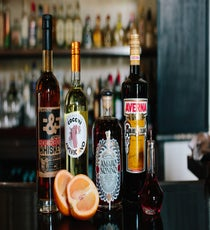You'll Need:  1 oz Cocchi Americano   1 oz bourbon (Dominic likes St. George's Breaking and Entering)  .5 oz Amaro Nonnino  2 dashes Peychaud's Bitters  Amaro Averna to coat the glass  1 grapefruit