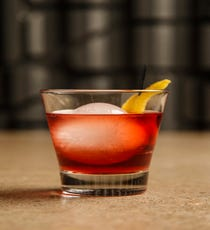 Whiskey Wolf of Wall Street Ingredients:  2 oz single barrel Evan Williams whiskey  .5 oz ruby port syrup  3 dashes Creole bitters Steps:   Add all of the ingredients into a rocks glass, stir for 10 seconds and garnish with an orange peel.