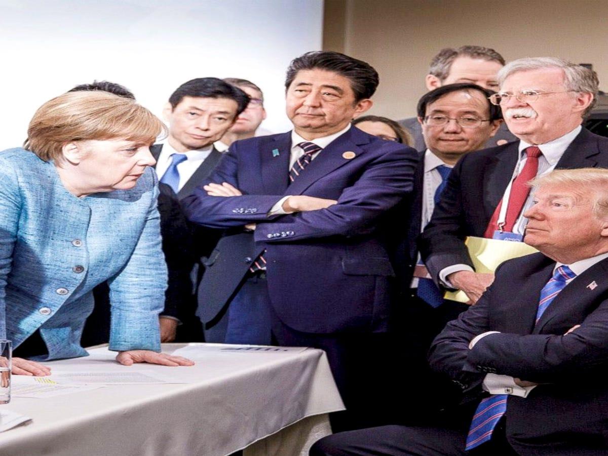 What Happened In This Iconic Photo Of Angela Merkel & Donald Trump?