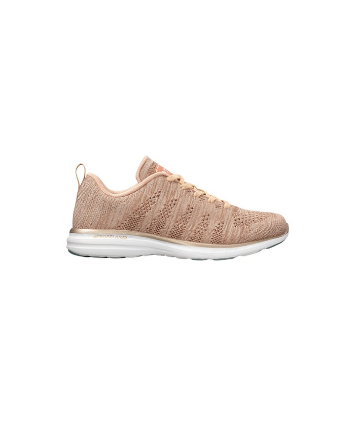 An iconic pair of rose gold APL Techloom sneakers to upgrade their favorite  athleisure look.