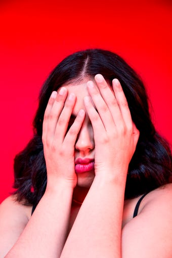 young woman covering face