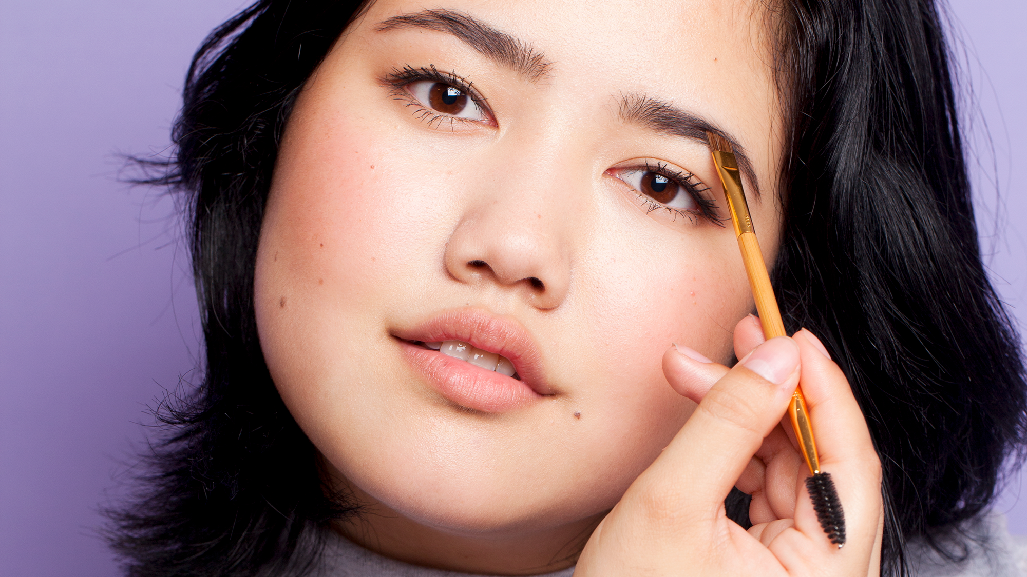 This Woman Used A Surprising Drugstore Product On Her Brows — & It's Genius