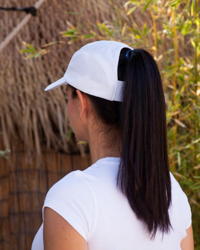 This Baseball Cap Solves The Most Annoying Lady-Hat Problem 8727d6f47e1