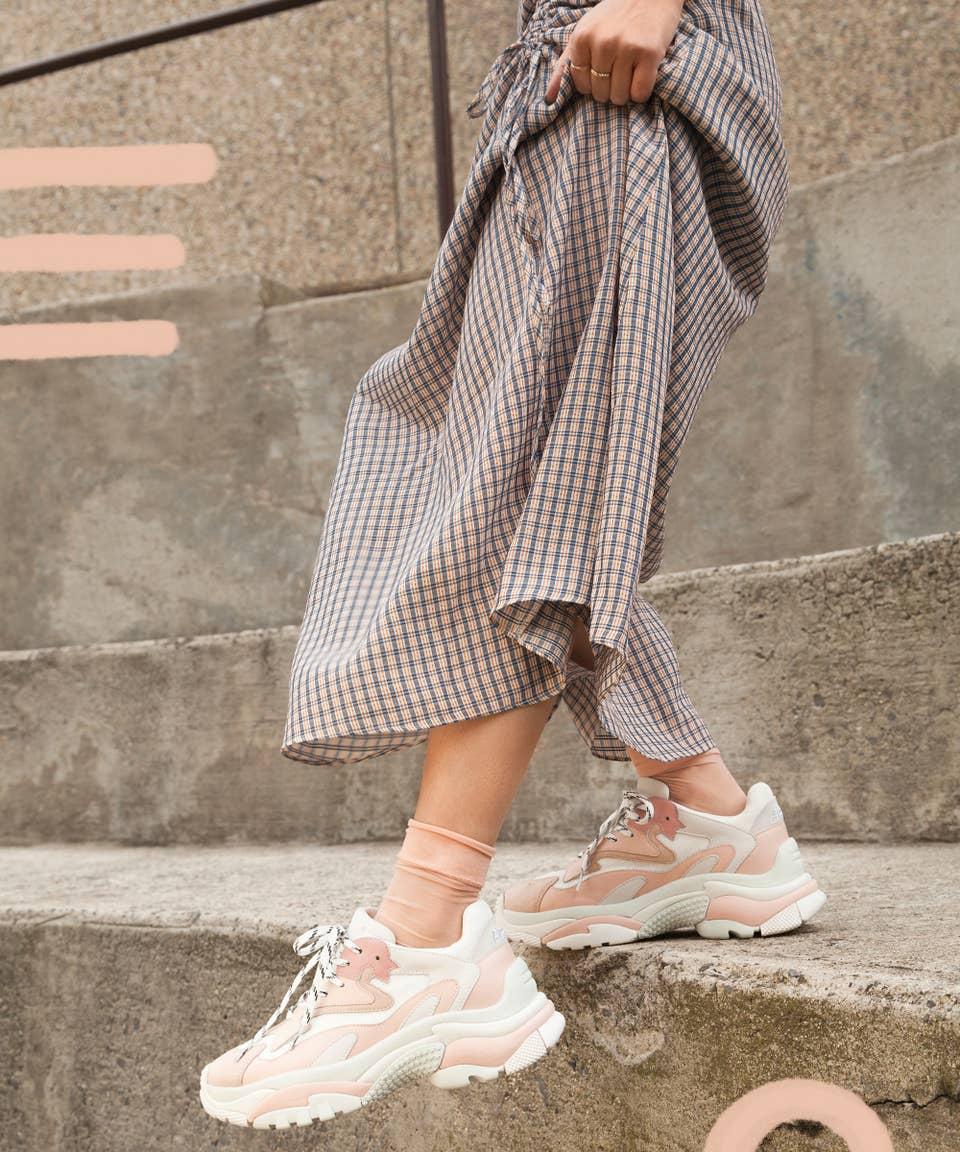 girl wearing fila shoes