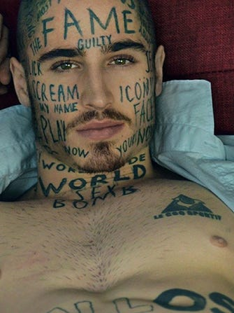 d6b9f013c2aeb This Model Gets YouTube Buzzwords Tattooed On His Face